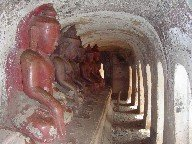 A series of Buddha statues in a cave